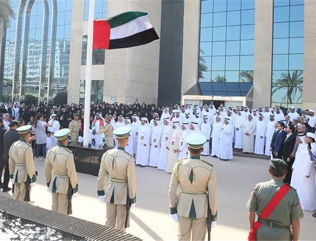 Raising the flag on the 49th national day